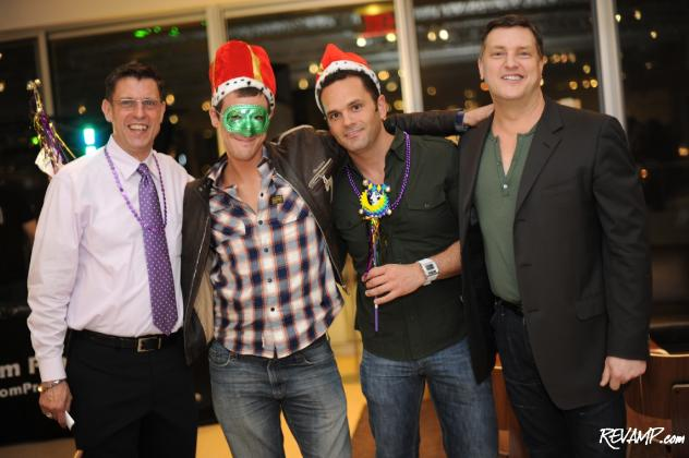 Vida Fitness' James Kameen and Room & Board's Scott Jussila flank the night's raffle winners.