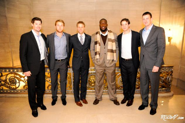 Eric Finn President Matt Landsberg stands surrounded by players from the Redskins and Capitals -- all decked out in the tailor's custom bespoke suits -- moments before they took to the runway for this year's 'Walk This Way' presentation.